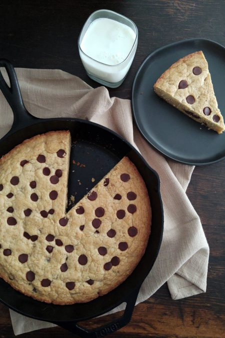 Finished cast iron cookie with glass of milk