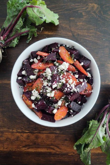 A white bowl of beets and carrots
