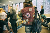 A suede jacket with hand sewn patches. Shot at the opening of the De Young Museum's Summer of Love exhibition