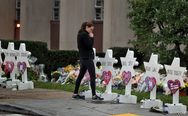 A woman reacts at a makeshift memorial outside the Tree of Life synagogue following Saturday's shooting at the synagogue in Pittsburgh, October 29, 2018.
