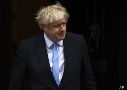 Britain's Prime Minister Boris Johnson walks out 10 Downing Street, in London, Britain, Sept. 5, 2019.
