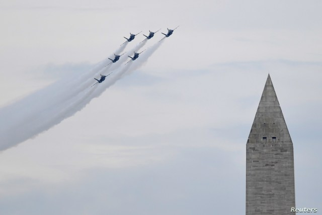 The U.S. Navy Blue Angels fly past the Washington Monument as President Donald Trump speaks during an Independence Day celebration in front of the Lincoln Memorial in Washington, July 4, 2019.