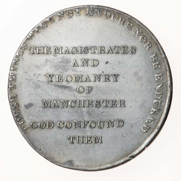 a round medal with an inscription