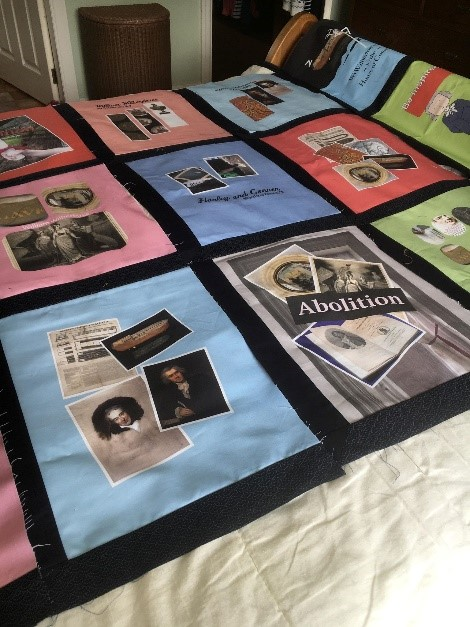 a quilt made from collaged pictures and phrases to do with the abolition of slavery