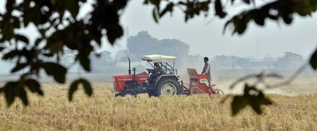 Agriculture_in_India_tractor_farming_Punjab_preparing_field_for_a_wheat_crop_without_burning_previous_crop_stalk