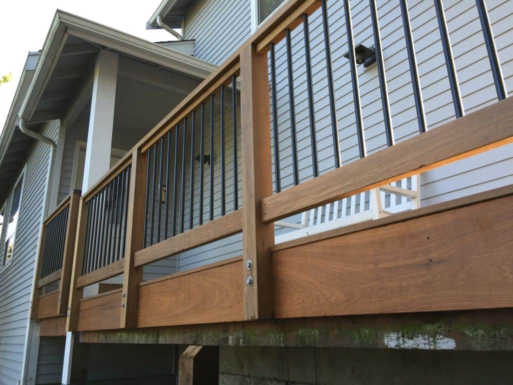 Ipe deck and rails with round aluminum balusters powder coated black.