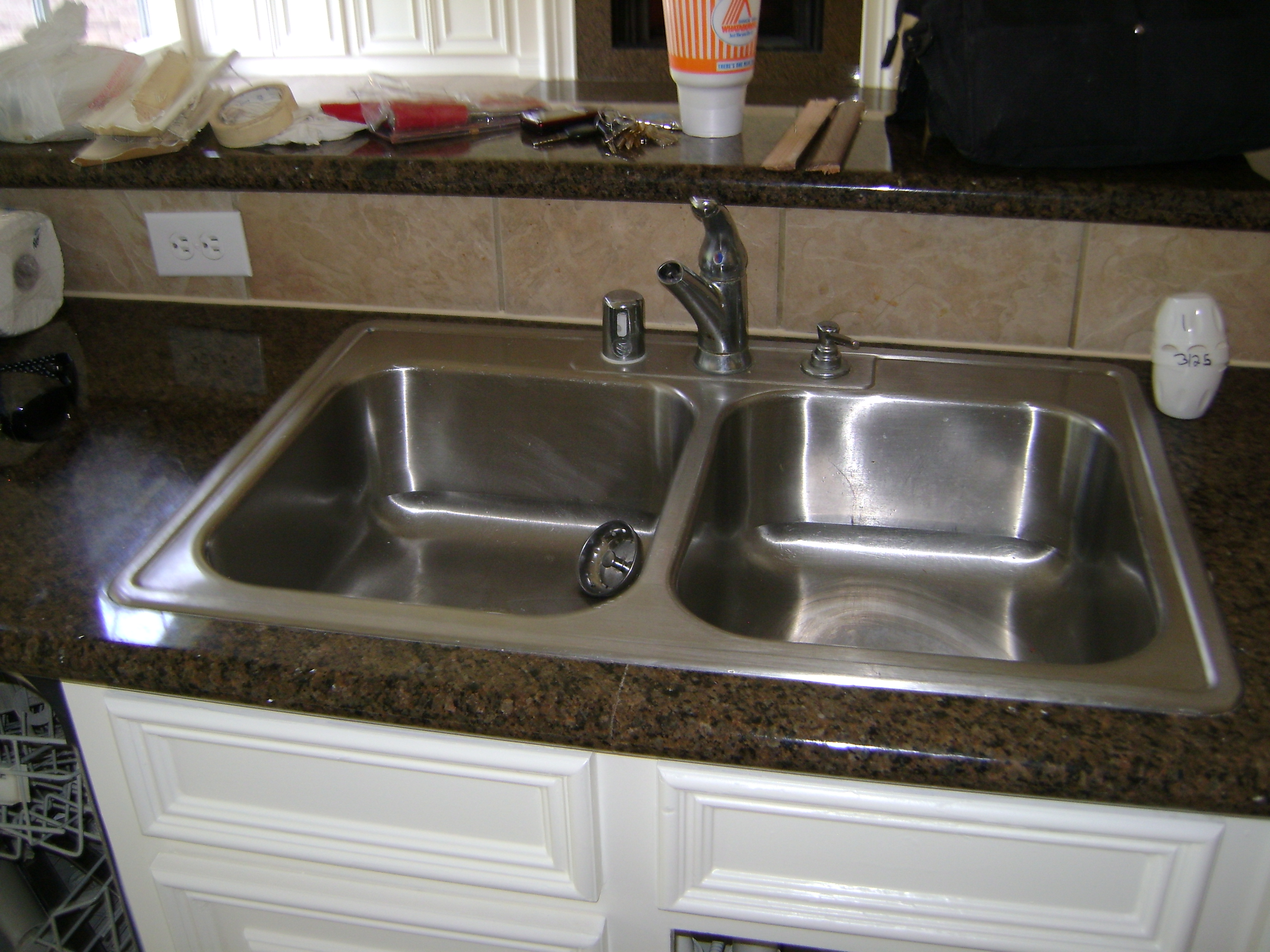 replace a kitchen sink and faucet