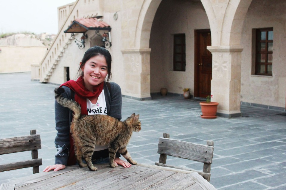 female solo traveler with cat in turkey