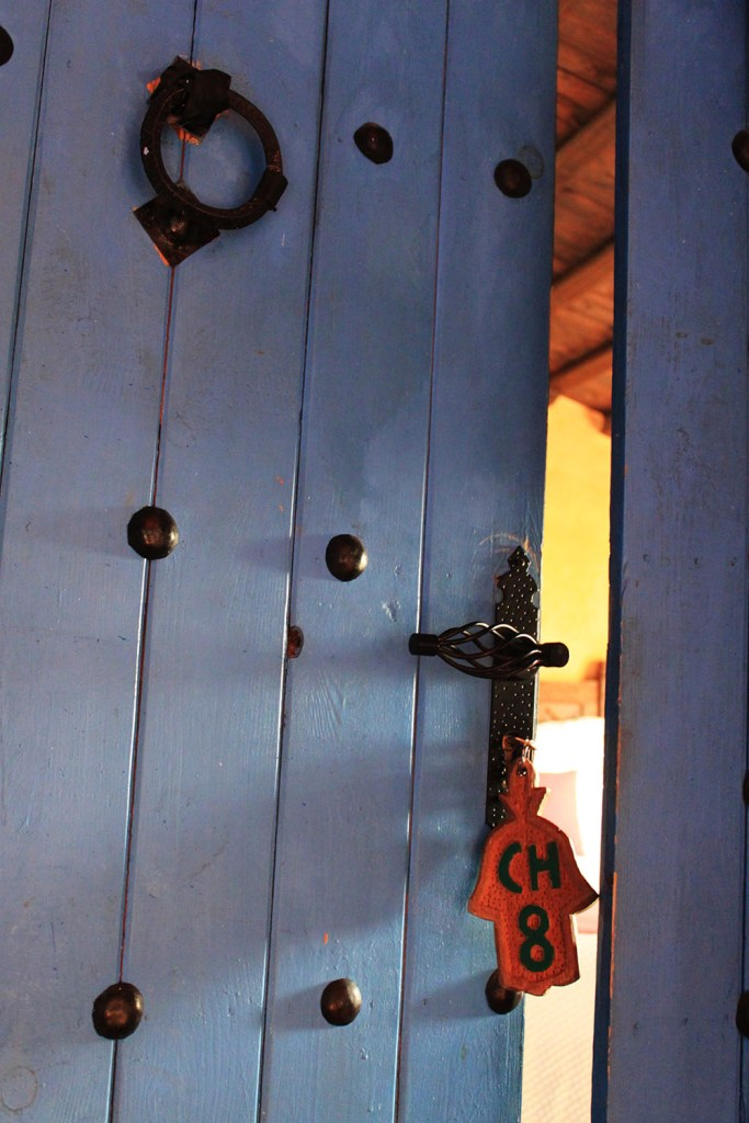 blue colour hotel door in chefchaouen morocco tour