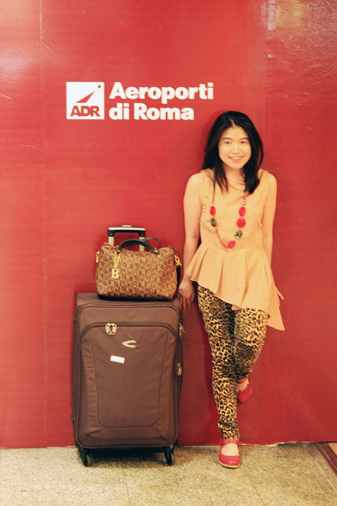 stylish girl in rome airport for romance