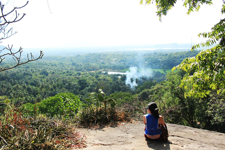 female solo traveler on top of sri lanka hill lonely planet top destination
