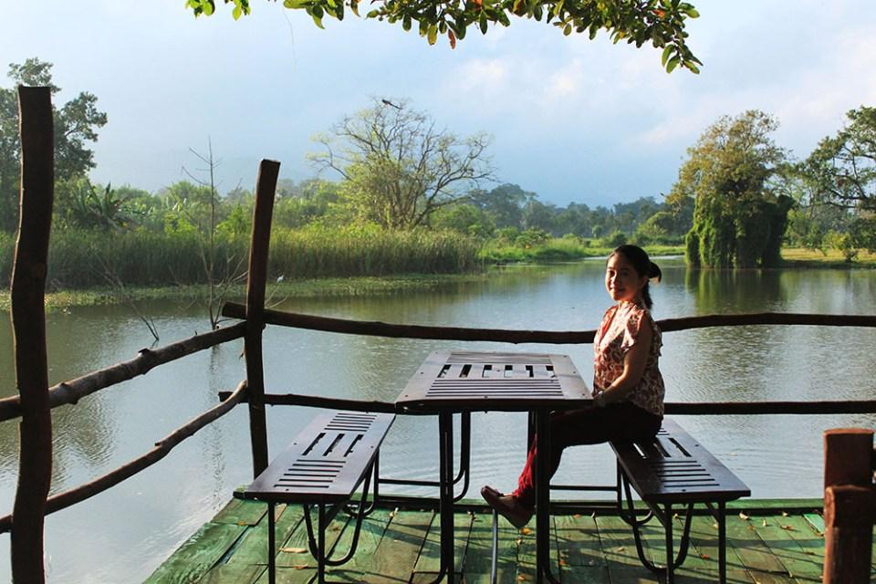 a girl sitting at beautiful natural lake m.p.s. village sri lanka