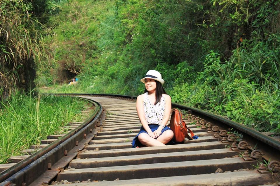 girl sitting in the middle of ella bridge train track sri lanka lonely planet destination