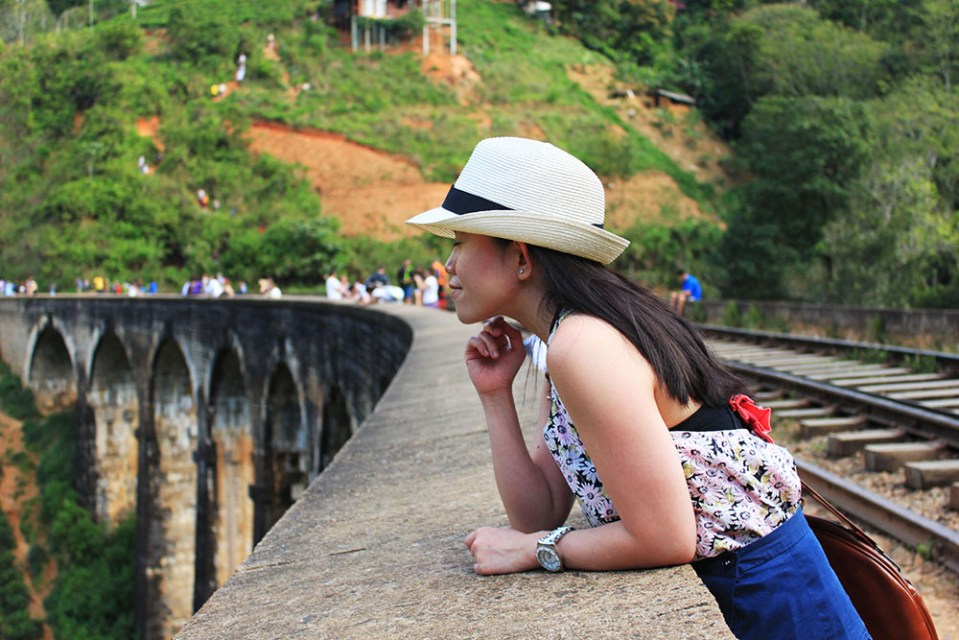 girl looking down from ella 9 arch bridge sri lanka lonely planet