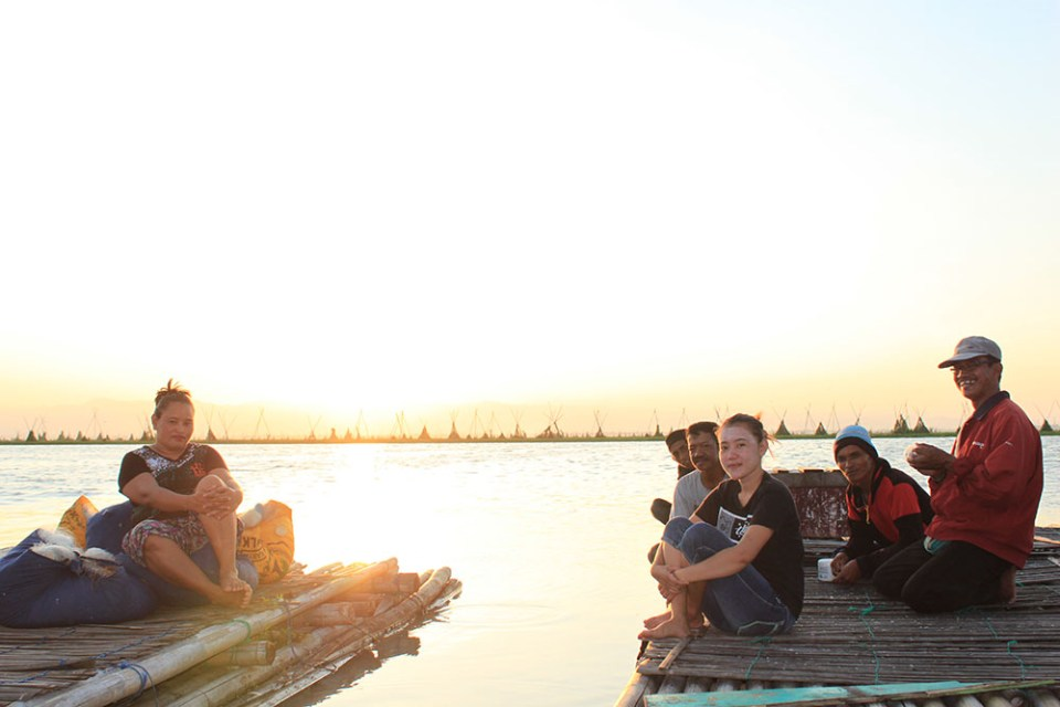 locals at floating house tempe lake indonesia during sunset