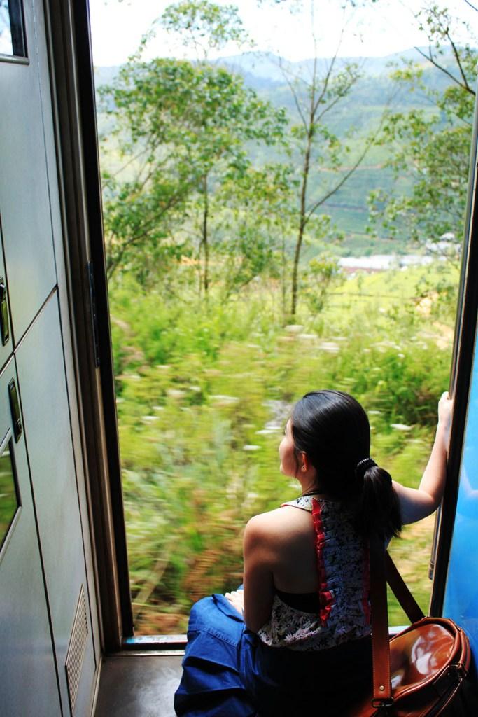 a girl enjoying scenic train ride sri lanka to ella