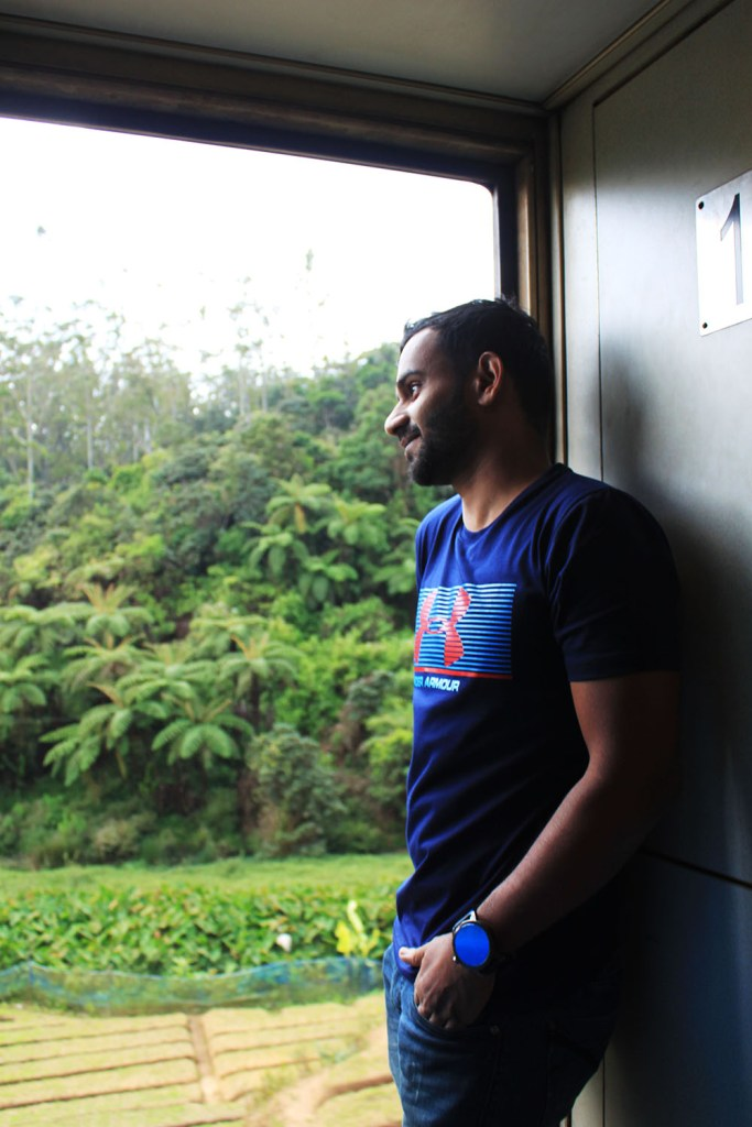 a male traveller in sri lanka scenic ella kandy train ride