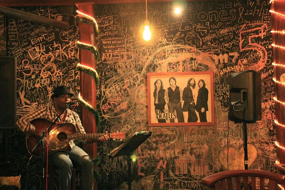 a singer performs at a bar in ella sri lanka