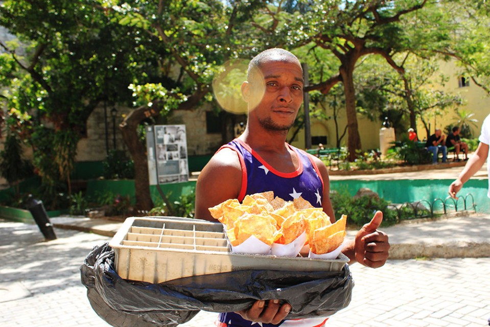 a street food seller offering snacks in havana cuba