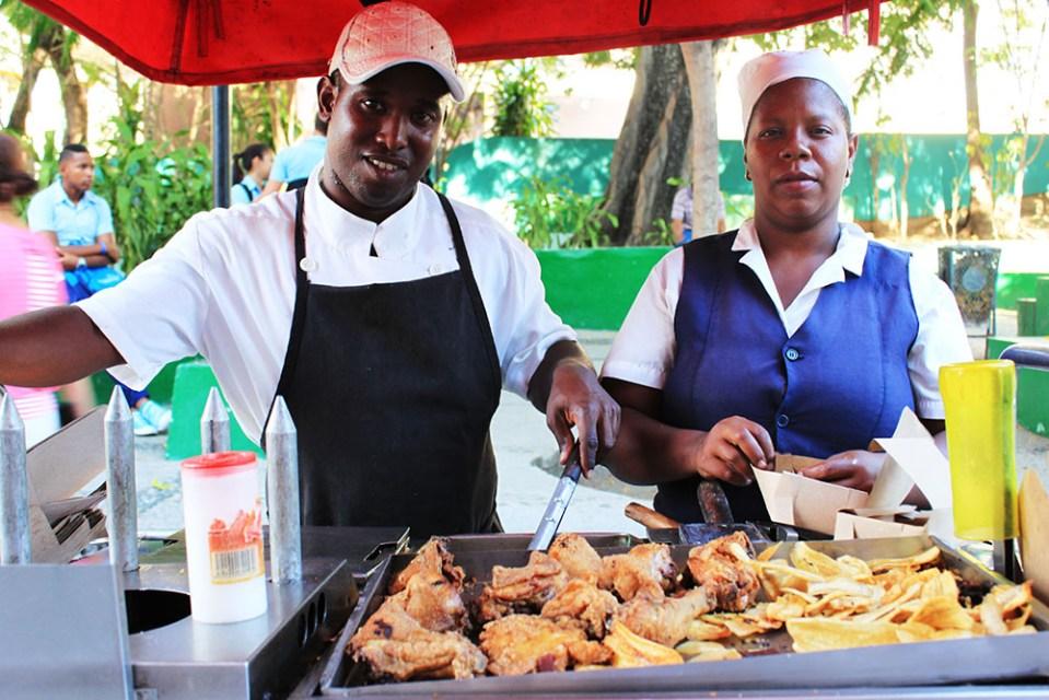 cuban street food seller with friend snacks