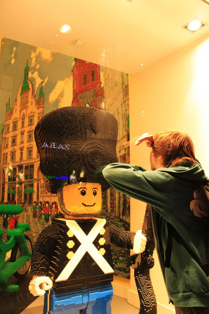A boy looking at a giant lego at Lego Store in Copenhagen, Denmark