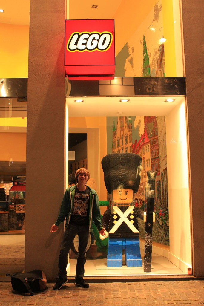 A boy and giant lego in front of Lego store in Copenhagen, Denmark
