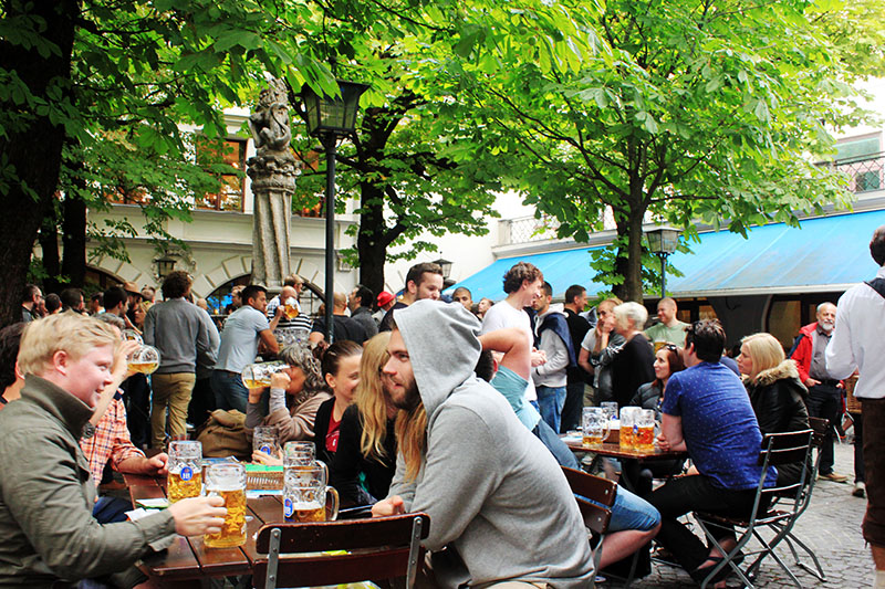 people gather outdoor drink beer oktoberfest munich