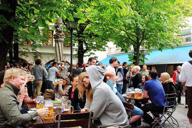 people gather outdoor drink beer oktoberfest munich