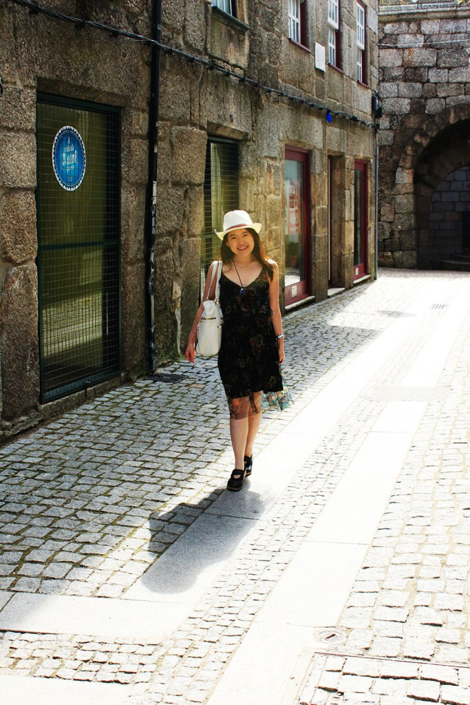 asian girl white fedora hat black flowery dress spain cobbled street agirlnamedclara