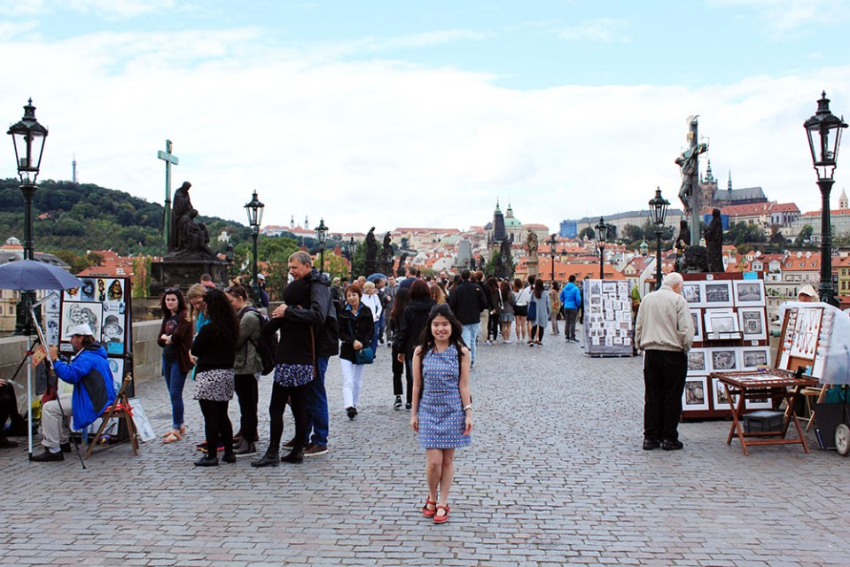 asian girl blue patterned dress on charles bridge prague czech republic agirlnamedclara