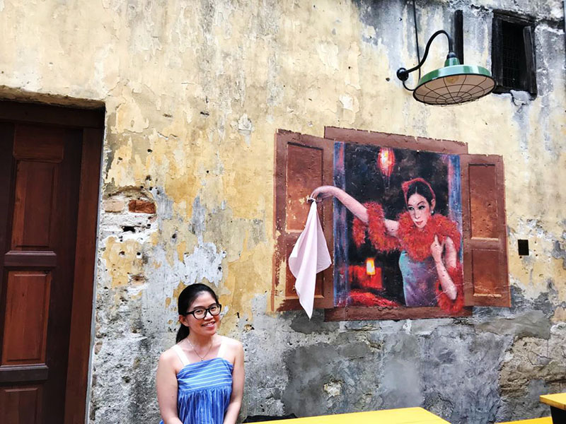 agirlnamedclara asian girl tourist traveler smiling eyeglasses concubine kl wall painting chinatown