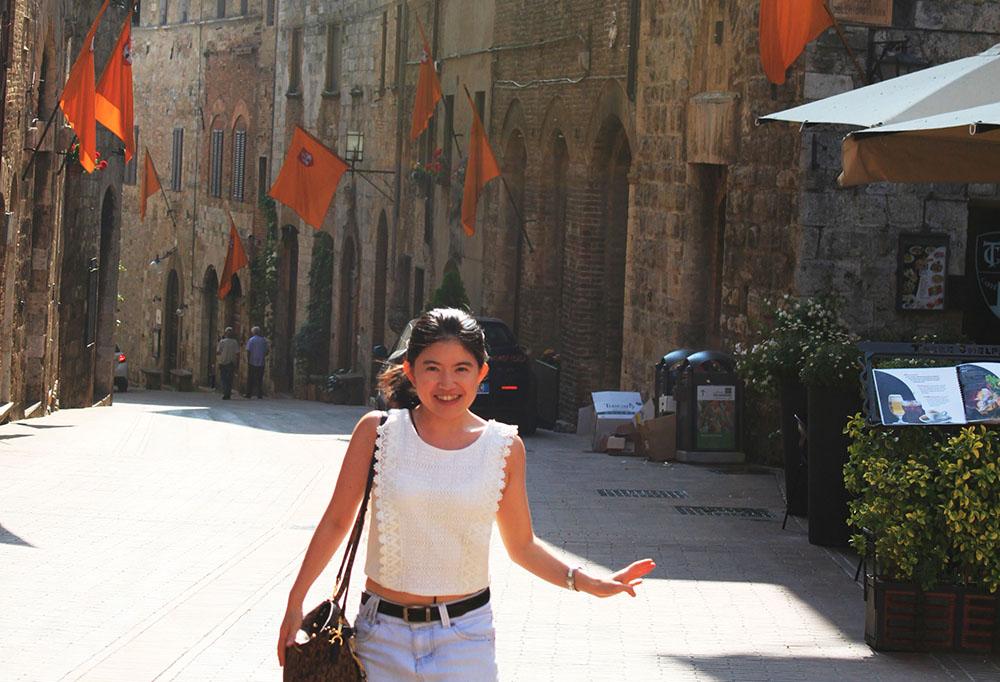little asian girl ponytail running smiling white dress italy cobbled stone street flags background morning sunshine agirlnamedclara
