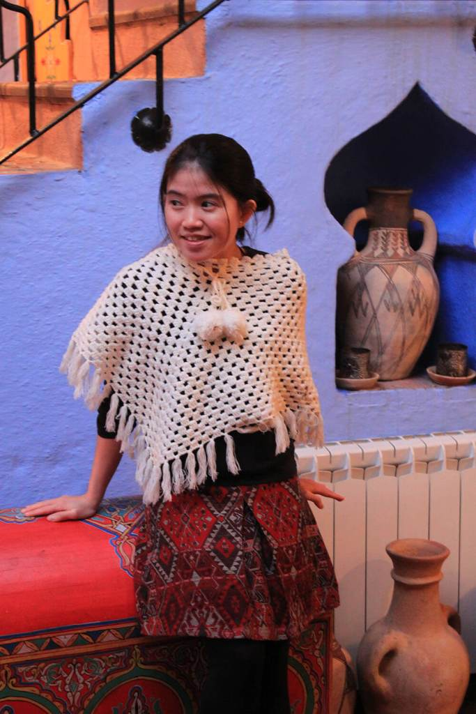 asian girl white poncho red skirt chefchaouen blue pearl morocco sitting_agirlnamedclara