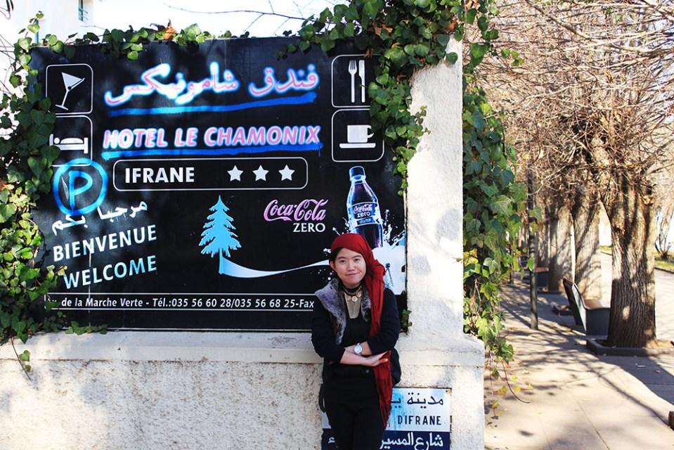 ifrane morocco atlas mountains fall autumn asian girl solo traveler pose smile standing against a wall agirlnamedclara