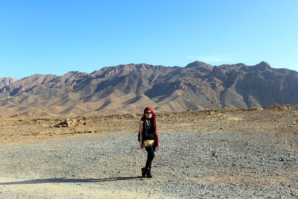 belly dancer shimmy asian girl solo traveler morocco mountains background