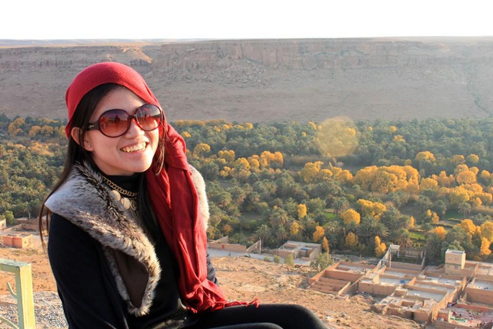 asian girl traveler smile morocco mountain palm valley background agirlnamedclara