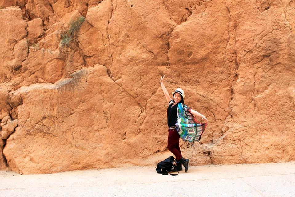 asian girl colorful butterfly clothes white fedora solo traveler todra gorge morocco agirlnamedclara