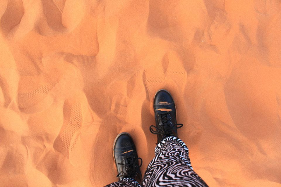 black boots zebra legging walking in sahara desert morocco agirlnamedclara