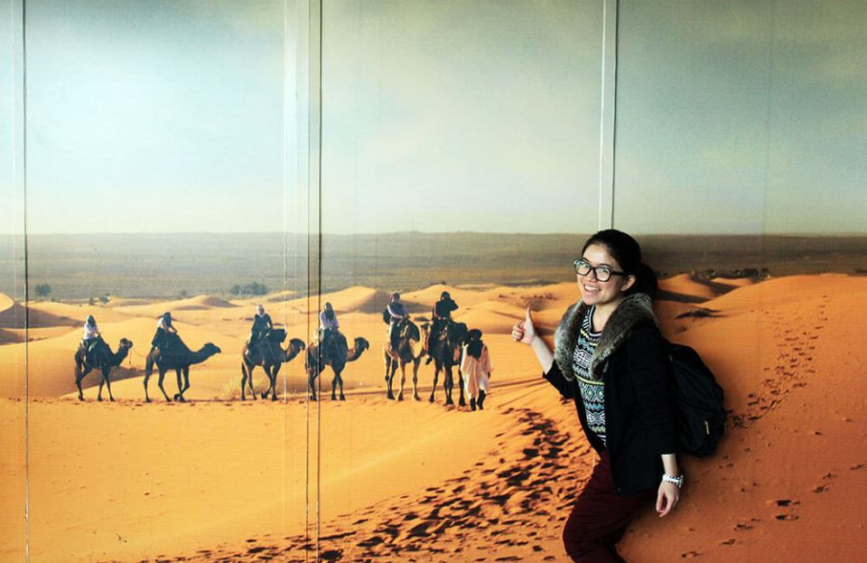 asian girl eyeglasses thumbs up morocco sahara desert background wall agirlnamedclara