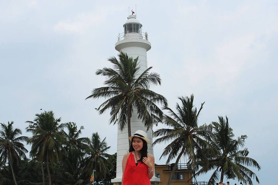 asian girl solo traveler red dress smiling galle fort bentota sri lanka background agirlnamedclara