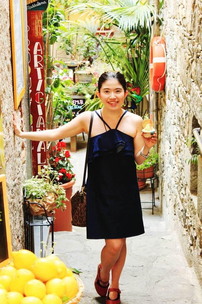 asian girl in blue dress smiling happy basil lemon gelato gelateria corniglia cinque terre italy agirlnamedclara