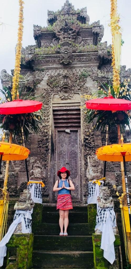 girl standing in front hindu temple bali penglipuran hari raya galungan festival agirlnamedclara