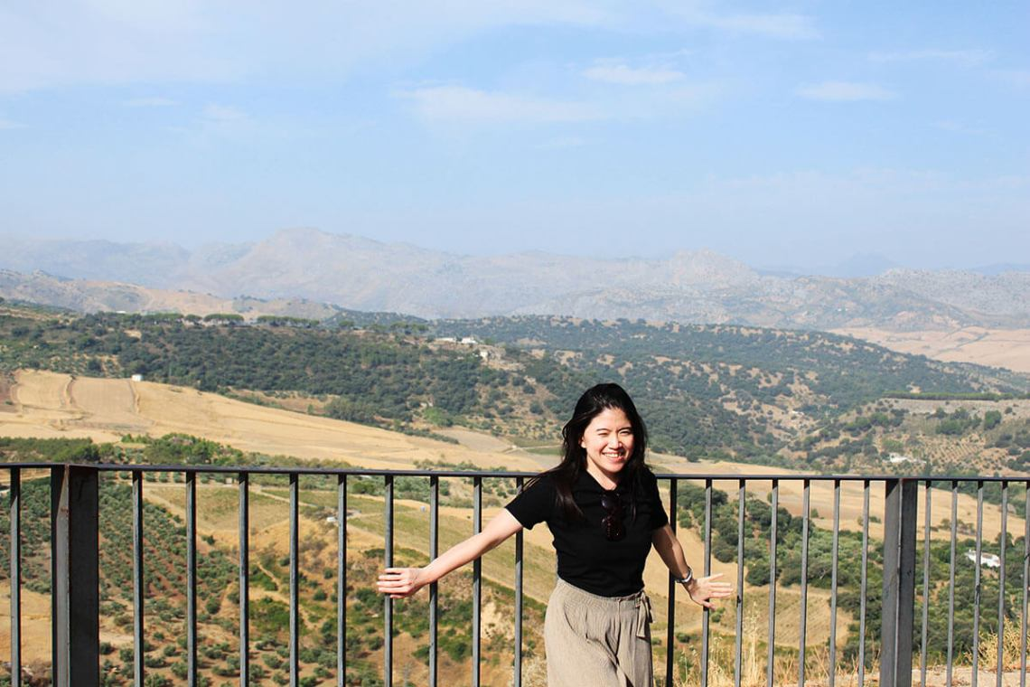 asian girl long hair smilling hills blue sky background ronda spain_agirlnamedclara