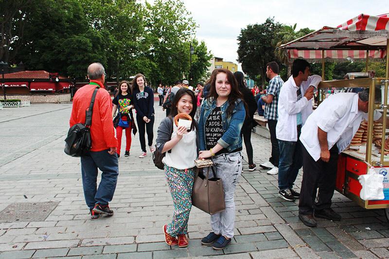 asian girl Turkish girl posing for camera and pretzel street food_agirlnamedclara