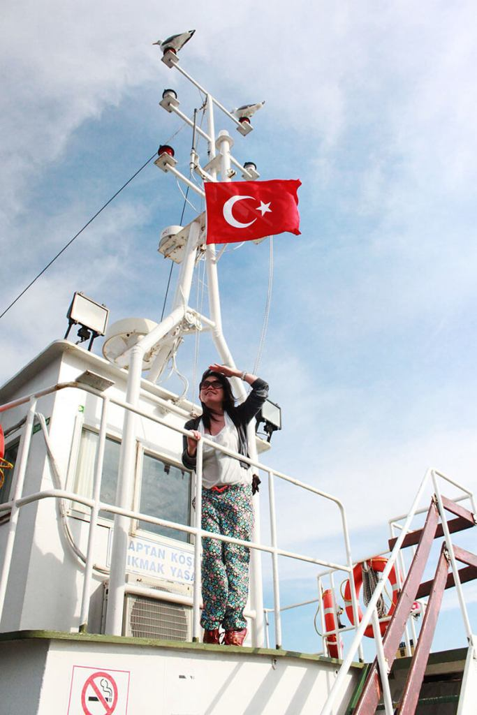 asian girl standing on a boat look far below turkish flag turkey marmara sea sailing_agirlnamedclara