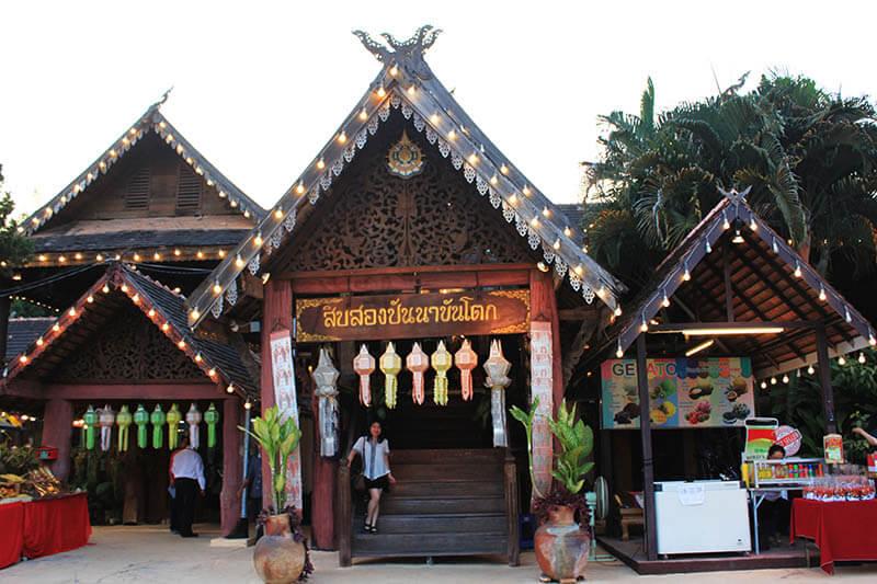 asian girl short hair white top black skirt pose in front of khantoke dinner restaurant chiang mai thailand_agirlnamedclara