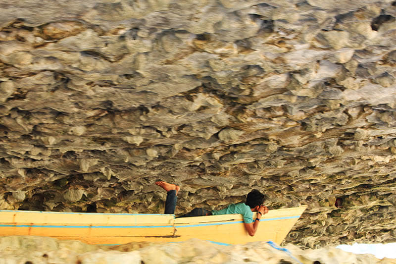 man sleep on a boat beneath karst stones dreaming_agirlnamedclara