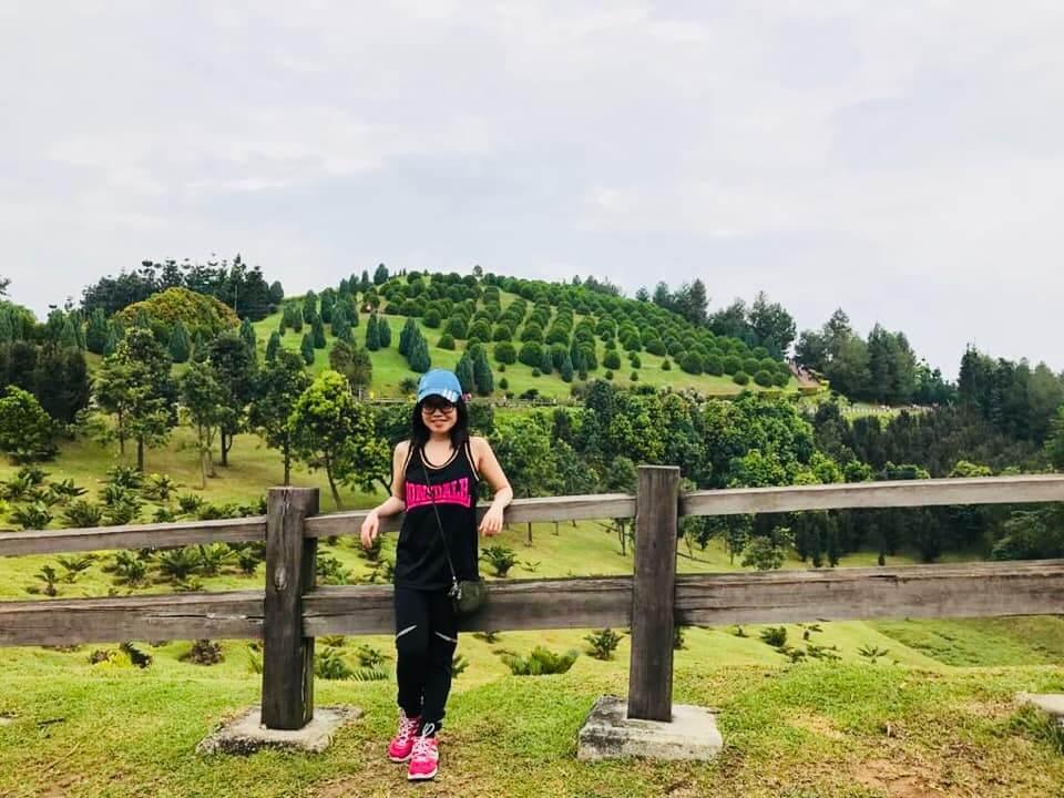 girl in black workout sleeveless top long pants blue adidas cap smile taman saujana putrajaya hill background_agirlnamedclara