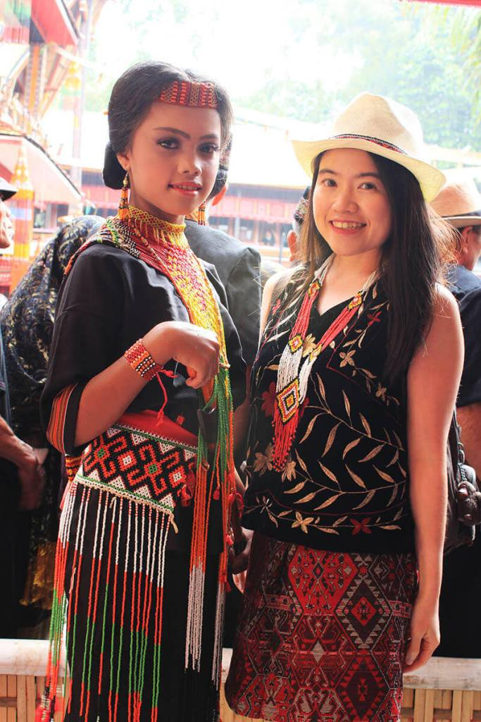 toraja dancer female asian traveler tourist smile pose for photo rambu solo_agirlnamedclara