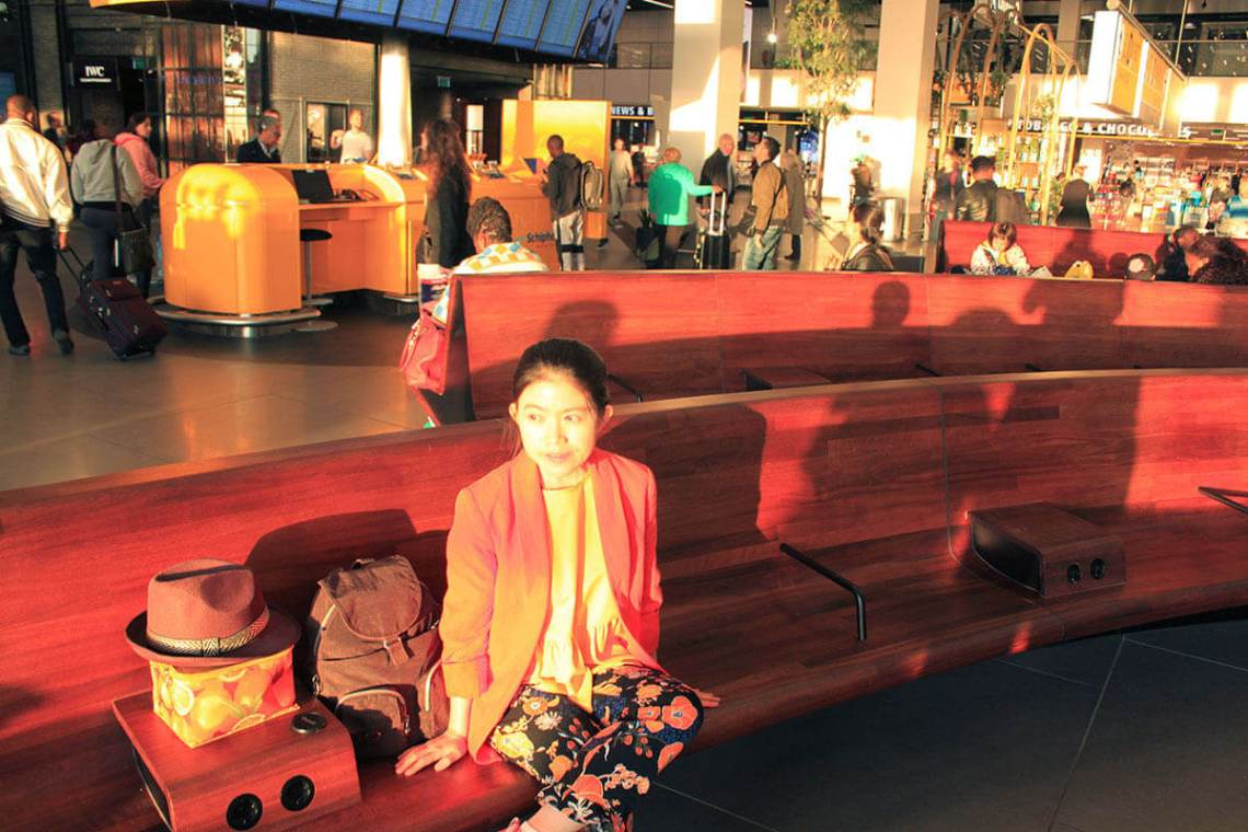 asian girl waiting at france airport sunrise soaked morning elegant chair_agirlnamedclara